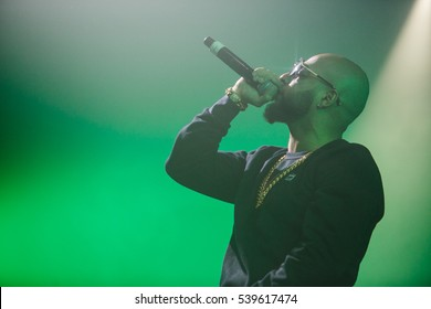 MOSCOW-8 DECEMBER,2016:Famous rapper sing in mic on concert in night club.Singer Nu Jerzey Devil singing in microphone on stage in green light.Hip hop music festival