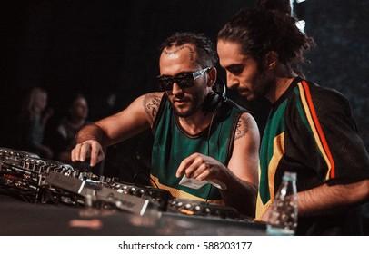 MOSCOW-8 FEBRUARY,2015: Dj MEG & DJ Nerak playing edm music set on stage of night club.Cool fashionable djs playing hip hop,trap & EDM musical show.Night entertainment event.Disc jockey mix tracks