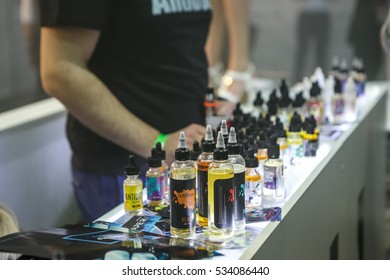 MOSCOW-9 DECEMBER,2016:popluar electronic cigarette filling liquid.Buye e-liquid.E-juice on sale in plastic bottle container.Tasty flavored glycerine liquids for smoking with vaping devices.