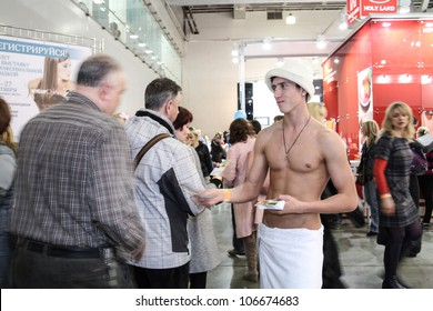 MOSCOW-APRIL 19: Man distributes flyers at the international exhibition of professional cosmetics and beauty salon equipment INTERCHARM on April 19, 2012 in Moscow