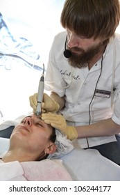 MOSCOW-APRIL 19: Procedure of HydraFacial at the international exhibition of professional cosmetics and beauty salon equipment INTERCHARM on April 19, 2012 in Moscow