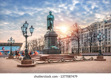 Moscow/Russia - 04/21/2019. A monument to Pushkin on Pushkin Square in Moscow and a pigeon on his head among the lanterns on a cloudy spring morning