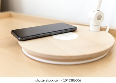 MOSCOW,RUSSIA 10 MARCH, 2018: Iphone X smart phone with wireless charger. Latest Apple Iphone 10 mobile phone. Illustrative editorial.