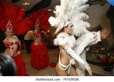 Moscow,Russia, 25 June 2017: Girls cabaret dancers in beautiful feathers dancing in the restaurant