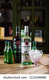 MOSCOW/RUSSIA - APRIL 24, 2018: Bacardi Superior Carta Blanca and Carta Negra rum, Sprite bottles and glass with ice cubes. Bacardi is sells more than million bottles of rum annually in 150 countries