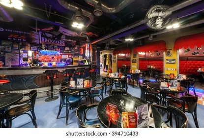 """MOSCOW/RUSSIA - DECEMBER 2014. Interior modern cafe-club """"1000 MILES"""". The main hall with bar and VIP tables"""