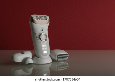 Moscow/Russia - february 16, 2020 new epilator Braun with reflection on white and red background