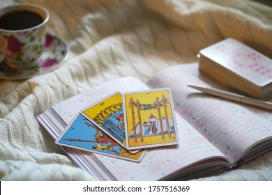 Moscow/Russia - June 2020: Selected focus of tarot cards layout, cup of Coffee and notebook. Tarot cards for tarot readings psychic as well as divination.