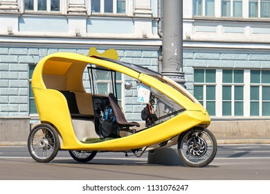 Moscow,Russia - June 23,2018. Yellow bicycle taxi on Moscow street