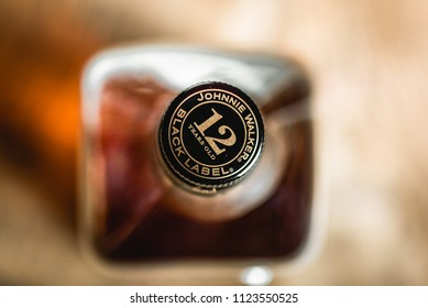 MOSCOW/RUSSIA - JUNE 25, 2018: Johnnie Walker Black Label bottle cork on whiskey bottle close-up. Johnnie Walker is Scotch blended whiskey and one of famous brands in world