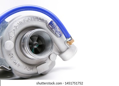 Moscow/Russia - MARCH 25,2019 background of new turbocharger Garrett isolated on white background. turbo compressor Garrett of car engine