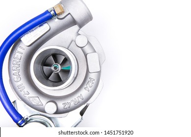 Moscow/Russia - MARCH 25,2019 new turbocharger Garrett isolated on white background. turbocharging of car engine. background of new car parts