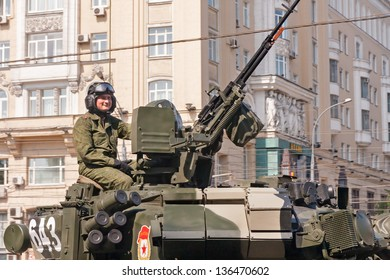 MOSCOW/RUSSIA - MAY 9: Russian officer sits on 2S19 Msta-S howitzer top near anti-aircraft gun on parade festivities devoted to 65th anniversary of Victory Day on May 9, 2010 in Moscow.