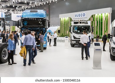 "Moscow,RUSSIA - SEPTEMBER 5, 2019: 15TH INTERNATIONAL EXHIBITION OF COMMERCIAL VEHICLES ""COMTRANS 2019"". visitors to the stand Iveco cars at the exhibition"