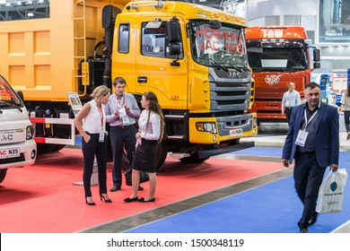 "Moscow,RUSSIA - SEPTEMBER 5, 2019: 15TH INTERNATIONAL EXHIBITION OF COMMERCIAL VEHICLES ""COMTRANS 2019"". visitors at the booth of JAC cars at the exhibition"