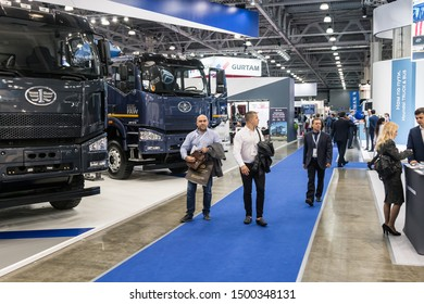 "Moscow,RUSSIA - SEPTEMBER 5, 2019: 15TH INTERNATIONAL EXHIBITION OF COMMERCIAL VEHICLES ""COMTRANS 2019"". visitors at the stand of FAW cars at the exhibition"