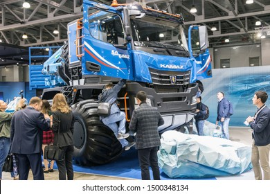 "Moscow,RUSSIA - SEPTEMBER 5, 2019: 15TH INTERNATIONAL EXHIBITION OF COMMERCIAL VEHICLES ""COMTRANS 2019"". visitors to the stand KAMAZ cars at the exhibition"