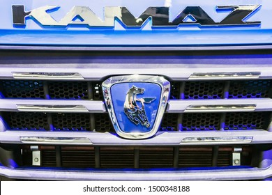 "Moscow,RUSSIA - SEPTEMBER 5, 2019: 15TH INTERNATIONAL EXHIBITION OF COMMERCIAL VEHICLES ""COMTRANS 2019"". KAMAZ company logo on a car at the exhibition"