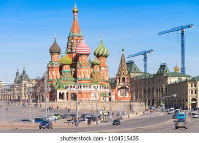 Moscow,Russia, St. Basil's Cathedral and Kremlin Walls and Tower in Red square in sunny blue sky. Red square is Attractions popular's touris in russia