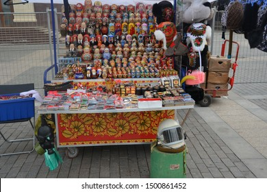 Moscow/Russia-10/05/2013: A souvenir stall in Moscow Red Square. You can find variety of Russian doll.           (babushka / matryoshka doll) Even you can find helmet of Yuri Gagarin or a gas mask.