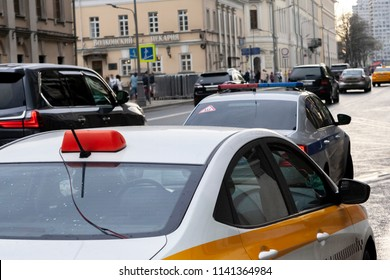 MOSCOW,RUSSIA-MAY 04 2018 :the car of the taxi was stopped by police officers on the city street. Service of the taxi is very widespread in Russia