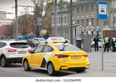MOSCOW,RUSSIA-MAY 04 2018 :the Yandex taxi car on the city street. Service of the taxi is very widespread in Russia