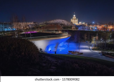 MOSCOW,RUSSIA-November 28,2019: Center of capital of Russia at night. Beautiful view on Zaryadye Park at night time. Peaceful yellow street lights and look on skyscraper designed in the Stalinist