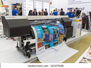 MOSCOW-SEPTEMBER 29, 2016: Business people are watching large format printers brand Japanese company OKI at the International Trade Fair  Advertising