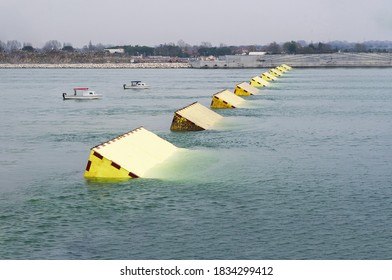 The MOSE System in Venice, Italy for the defense against high waters. Yellow barrier against the high water in the defense of Venice Lagoon. New generation of flood prevention system.