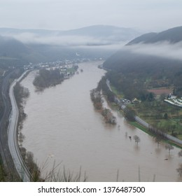 Moselkern, Rheinland-Palz / Germany - January 6 2018: Flooding Mosel (Moselle) River from above with Moselkern town in Rheinland-Pfalz, Germany.