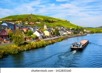 Moselle river by Wormeldange, Luxembourg country, with vineyard hills and a cargo barge ship