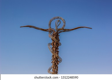 Moses staff landmark religion object on empty blue sky background in Jordanian city Madaba in Middle East region of Earth, copy space