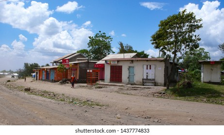 Moshi, Kilimanjaro Province / Tanzania: 2. January 2016: country village made of recycled materials on the roadside in Tanzania with shops and small homes for local people