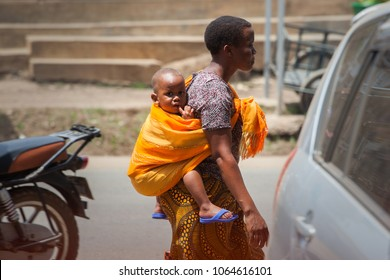 Moshi/Tanzania - 1 February 2018: A woman with her child on her back.