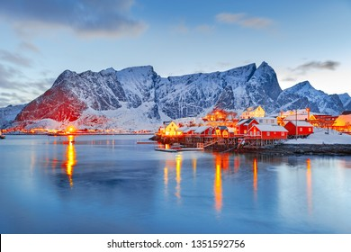 Moskenes island on Lofoten islands archipelago  in Norway over polar circle, Scandinavia, Europe - Lovely dusk scene of Villages Reine and Hamnoy: Reine fjord and snow-capped mountains in background.
