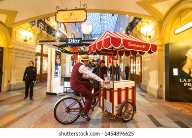 Moskow / Russia - 01.23.2017: A man in a bicycle suit with a basket drives a shopping center selling popcorn.