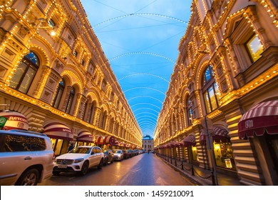 Moskow / Russia - 01.23.2017: Street with buildings decorated with garlands. Pre-Christmas decoration of the city. Christmas lights on buildings. Christmas story.