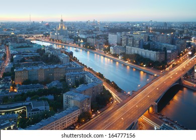 Moskva River and Building on Kotelnicheskaya Embankment at summer night in Moscow, Russia. Long exposure. View through window.
