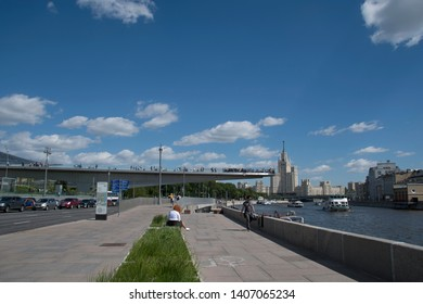 Moskvoretskaya embankment,Moscow,Russia-May,20 2019-Embankment along the Moscow river,floating bridge in Zaryadye park view to Stalin's building at Kotelnicheskaya embankment in city center.editorial.