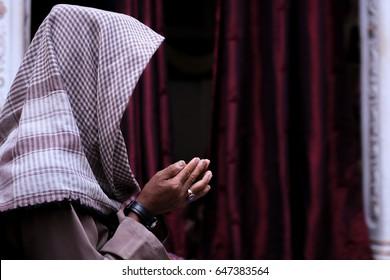 Moslem man recite a Dua in a holy Ramadan month over nice dark background