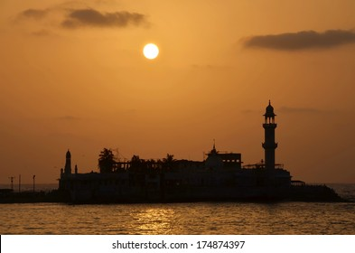 Mosque Haji Ali in Mumbai at sunset; Mosque was built in 1431 in memory of a rich Muslim merchant