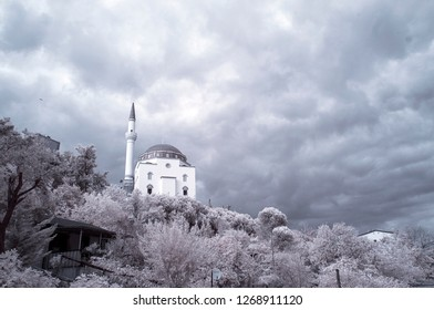 mosque holy cami camii minaret infrared photo with snowy trees