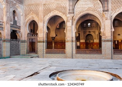 Mosque interior courtyard featuring elaborate tile, wood and plaster decoration .  Location: Fes, Morocco