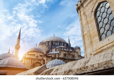 Mosque in Istanbul, Turkey. Architectural monument. Center of Islam. Cami. Mescit. Sky, sun and clouds on the background