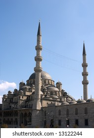 Mosque in Istanbul with two minarets over blue sky