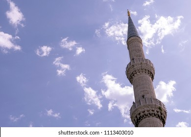 Mosque, minarets against a clear blue sky on a sunny day