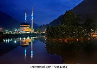 A mosque reflected in Uzun lake (Uzungol), Trabzon Province, Black Sea region, Turkey. Date taken: 25.7.2010