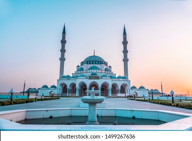Mosque in Sharjah beautiful traditional Islamic architecture new tourist attraction Arabic Letter means:Indeed, prayer has been decreed upon the believers a decree of specified times