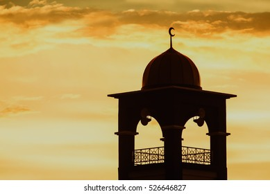 Mosque in a sunset over a cloudy sky. tone image.