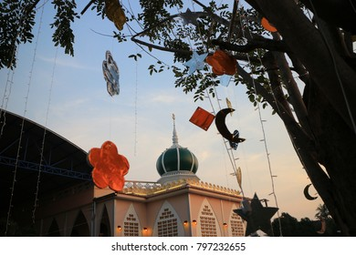 mosque in sunset and a tree